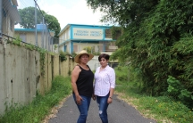 Two women in front of school