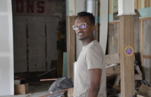 Hamissi Mamba walks through the guts of what will be his new restaurant, Baobab Fare in Detroit. Originally from Burundi, Mamba relocated to Michigan two years back, learned English, and is now a budding entrepreneur.