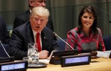 USPresident Donald Trump speaks as UNAmbassador Nikki Haley looks on