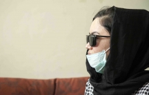 Zahra, a Hazara, at Dr. Zalmai Khan Ahmadzai's clinic in Kabul. She says she wants to get a nose job.