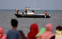 A rescue team aboard a boat is shown heading out to the Lion Air flight JT610 sea crash location.