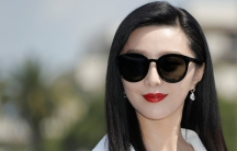Fan Bingbing is shown in a close-up portrait photo with dark sunglasses on.