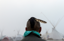 a man stands at near Standing Rock North Dakota