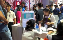 People visit a nail polish booth at the China Import and Export Fair in Guandgong province, China.