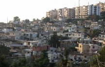 Crowded homes and buildings stacked on a hill.