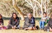 A group of Aboringinal women are shown sitting during a Sunday picnic in Telegraph Station in Alice Springs.