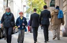 Two men in suits walking down New York steet