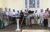 asylum-seekers sing in a church choir