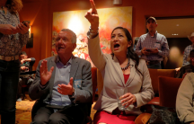 Democratic congressional candidate Deb Haaland reacts upon learning that fellow Native AmericanShariceDavidsof Kansas also won her midterm election