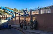 USArmy soldiers install razor wire