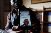 A former UN official campaigning for peace shows a threatening message posted against him on social media by separatists