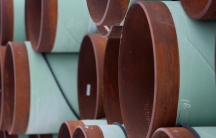 Copper and blue colored pipes are shown stacked on their sides in Gascoyne, North Dakota.