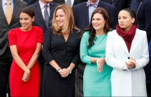 Four women are lined up for a group picture.