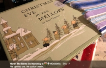 """A book is sitting in torn Christmas paper. The title of the book is """"Christmas Eve at the Mellops"""" and a photo caption underneath says """"We opened one. We couldn't resist."""""""