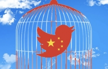 Twitter bird with Chinese flag colors in a cage.
