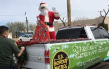 A man wearing a Santa Claus costume arrives in a pickup truck in El Paso, Texas.