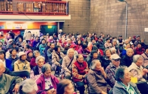 A room full of mostly elderly Asian residents of San Francisco'ssit in a large room as they attend a talk on protecting themselves from immigration enforcement.