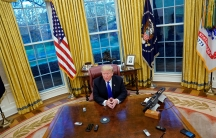 """President Donald Trump answers questions during an exclusive interview with Reuters journalists in the Oval Office at the White House in Washington, DC on December 11, 2018. Asked about his past business connections with Russia, Trump said, """"The stuff yo"""