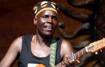 Oliver Mtukudzi plays guitar