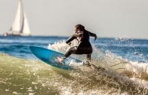 A woman riding a wave