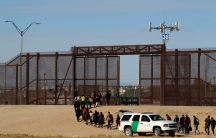 Migrants from Central America are seen escorted by US. Customs and Border Protection (CBP) officials after crossing the border from Mexico to surrender to the officials in El Paso, Texas in this pictured taken from Ciudad Juarez, Mexico.