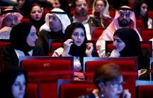 Saudi women attend a concert featuring the Greek perfomer Yanni at Princess Nourah bint Abdulrahman University in Riyadh, Saudi Arabia on December 3, 2017.
