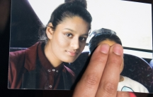 Renu Begum, sister of teenage British girl Shamima Begum who left the UK to join ISIS, holds a photo of her sister as she makes an appeal for Shemimato return home
