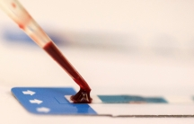 a drop of blood being placed onto a slide