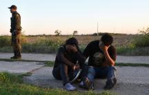 US border patrol apprehending migrants