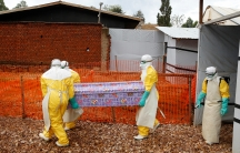 workers carrying coffin of a victim of ebola