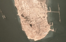"""Satellite view of the Kharg Island oil export terminal in Iran. Very Large Crude Carriers  — """"supertankers"""" — can be seen loading on the sides."""