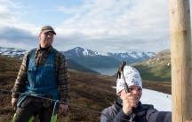 Sámi renideer herder Reiulf Aleksandersen and his son build a fence for gathering their herd on Rooksavardi, or Red Mountain, in far northern Norway.