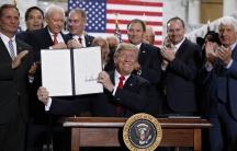 US President Donald Trump displays an executive order