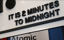 """A sign reads: """"It's 2 minutes to midnight"""""""