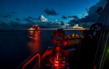 war ships at night