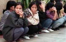 Thai women sitting on a sidewalk in El Monte, California