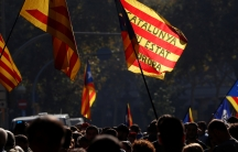 Demonstrators gather outside the Catalan regional parliament in Barcelona, Oct. 27, 2017.