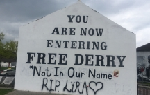 A message has been spray painted onto a stone monument.