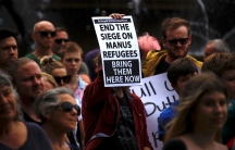 Refugee advocates hold placards as they participate in a protest in Sydney against the treatment of asylum-seekers at Australia-run detention centers