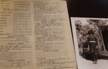 Image of old report card with black and white photo of young girl