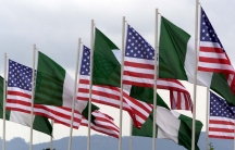 American and Nigerian flags fly next to each other in the center of Abuja August 24, 2000.