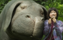 """A scene from the movie """"Okja,"""" featuring the title creature — a humongous pet pig."""