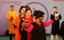 """Acid attack survivors walk on the ramp as they participate in a fashion show titled """"Beauty Redefined"""" organized by ActionAid in Bangladesh earlier this year."""