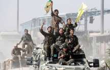 Syrian Democratic Forces (SDF) celebrate the defeat of ISIS in Raqqa, Syria.