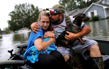 Couple in a boat in flood waters