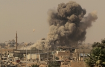 Smoke rises after an air strike during fighting between members of the Syrian Democratic Forces and Islamic State militants in Raqqa, Syria,