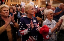 Supporters cheer at a Republican Senate candidate Roy Moore campaign rally in Midland City, Alabama.