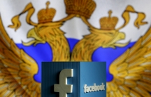 Facebook logo with the Russian flag