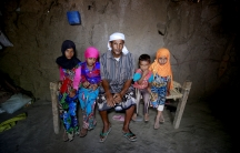 Saida Ahmed Baghili, second from left, 19, who is recovering from severe malnutrition, poses for a photograph with her father and her sisters Jalila, left, 12, and Amal, right, 7, and 4-year-old brother Omar at their hut in al-Tuhaita district of Hodeidah