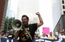 """CesarEspinosa, animmigrant rights' activist and head of FIEL, leads demonstrators protesting the Trump administration's immigration policies as part of a """"Families Belong Together"""" rally in Houston, Texas,June 30, 2018."""